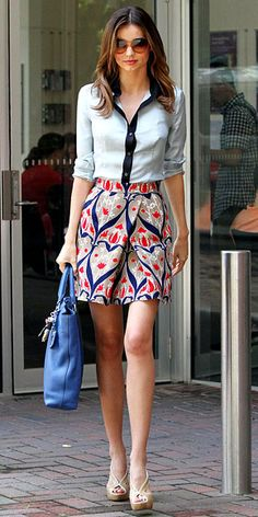 Kerr paired a navy-accented button-down with a bold print skirt and finished the look with a bright blue bag and nude sandals