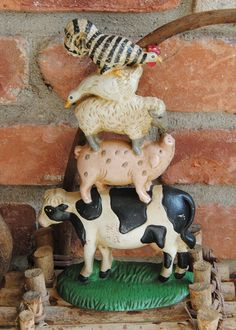 barnyard animal doorstop with rooster, duck, sheep, pig and cow