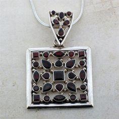 Garnet pendant sterling silver.  $199.99
