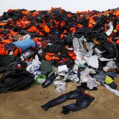 Thousands of life vests left by migrants and refugees are piled up at a garbage dumpsite on the Greek island of Lesbos October 19 2015. Almost 400000 people have arrived in Greece this year according to the U.N. refugee agency UNHCR. Photograph by Yannis Behrakis of @reuters. by time