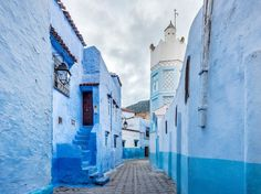 """Tucked high in Morocco's Rif Mountains, the all-blue town of Chefchaouen is a calming respite from the overwhelming frenzy of Marrakech and Fez. The Jewish refugees from Europe who lived there during the 1930s first painted the city (either to symbolize heaven or as a mosquito repellent, depending on who you ask), and now the town is known as """"The Blue Pearl."""" The town still keeps the tradition alive: Each year, the houses are washed with new coats of paint. —Lucy Laucht"""