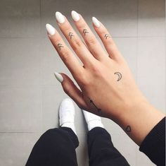 arrows moon and heart hand tattoos, small tattoos for men, woman wearing white nail polish, white sneakers Arrow Tattoo Finger, Small Finger Tattoos, Arrow Tattoos, Small Tattoos, Tattoos For Guys, Tattoos For Women, Cool Tattoos, Tattos, Girly Tattoos