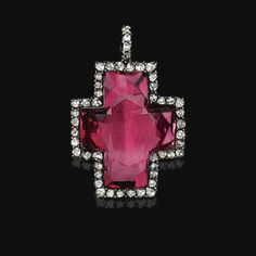 SPINEL AND DIAMOND PENDANT, END OF 18TH CENTURY. The cross-shaped faceted spinel bordered by rose-cut diamonds.