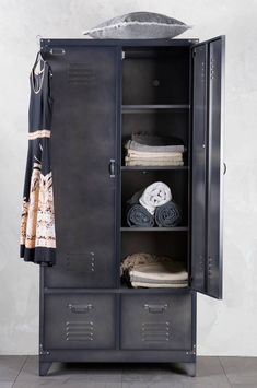 Industrial Style Locker for storage solutions in the home, one side for hanging rail the other has 4 storage compartments, 2 drawers at the bottom.