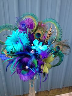 Peacock wedding bouquet. Bridal bouquet sparkling crystals, beautiful brooches, & peacock feather bouquet. Discounts price on sets via Etsy