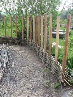 This shows wattle fencing in progress around a cottage kitchen garden