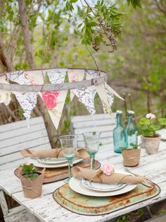 could DIY this bunting with an embroidery hoop. A Hoola Hoop would be great, too.