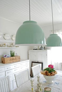 mint green lamps above dining table