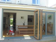Bi-fold doors - grey exterior and wood interior - grey a little too light but they do a nice darker petrol blue grey