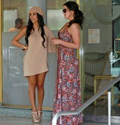 Kourtneys outfit. Never would have thought to put a hat like that with a cute dress and heels.