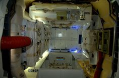 Interior view of the dragon module. SpaceX's Dragon unmanned cargo spacecraft successfully docked with the International Space Station on May 25, 2012, the first commercial vehicle to do so. Photo taken by Dutch astronaut André Kuipers.