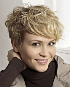 Blonde pixie cut zith curly styling.