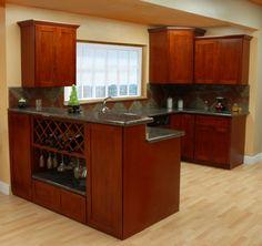 Dark cherry wood with dark counter tops and light floor