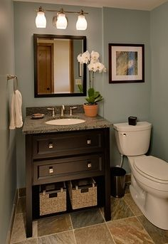 Nice possibility for a half bath, also like the elongated toilet bowl and love the flooring