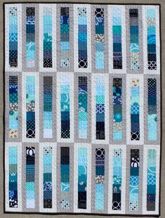 Wish this gorgeous quilt was queen size instead of a baby quilt. Love the colors and the attention to detail. (Chance of Showers Baby Quilt by teaginnydesigns)