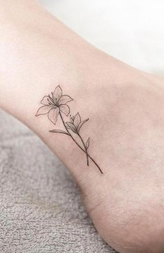 Small Wild Flower Black and White Ankle Tattoo Ideas for Women Tiny Sketch Foot . - Small Wild Flower Black and White Ankle Tattoo Ideas for Women Tiny Sketch Foot … – - Delicate Flower Tattoo, Lily Flower Tattoos, Flower Tattoo On Ankle, Ankle Tattoo Small, Tattoo Flowers, Small Lily Tattoo, Delicate Tatoos, Small Foot Tattoos, Daffodil Tattoo