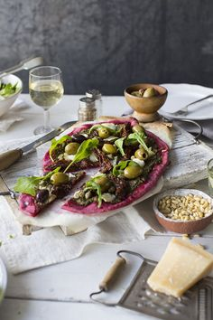 Beet Pizza with Beet Leaf Pesto | Veggie Desserts Blog This vibrant beet pizza is eye-catching and delicious. Plus, it uses the entire beetroot – from root to leaf – in the pizza, beet leaf pesto and toppings.