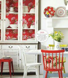 GREAT IDEA to add color to back of cabinet A touch of red. So often, I do the back of the cabinet built-in, or the free-standing china cabinet or pie safe with wallpaper, pressed-tin paintable wallpaper, or even fabric. Adds a bit of fun. White Cottage, Cozy Cottage, Cottage Style, Red Kitchen, Vintage Kitchen, Kitchen Decor, Ideal Home Magazine, Sweet Home, Decoration