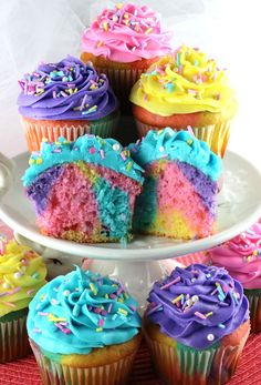 Celebration Marble Cupcakes - a beautiful and colorful cupcake that would be a great Easter dessert or wow at a Birthday Party, a Baby Shower or just a random Wednesday. Cupcakes never looked so good or were so easy to make. What a fun and delicious Easter Treat. Follow us for more fun Easter Food Ideas.