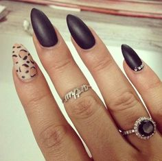 I love the color the leopard print but Stilleto nails are not cute in my opinion.