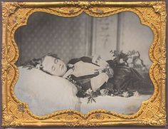 ca. 1858, [post mortem ambrotype portrait of a young boy surrounded by flowers] via Christopher Wahren Fine Photographs, Skylight Gallery