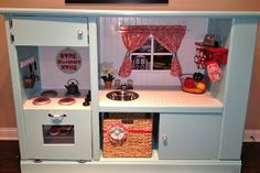 Play kitchen from entertainment center. Love this one!