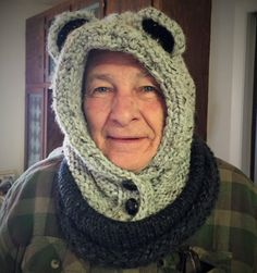 Hooded cowl with bear ears, knitted in dark and light gray chunky yarn. Two buttons at the neck let you tighten up on very cold days. This hood