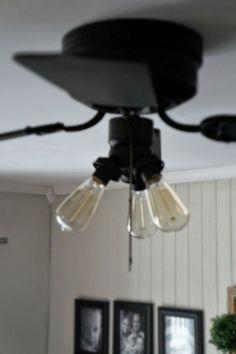 Super Easy Industrial Style Fan Makeover - Seeking Lavendar Lane Updating a Ceiling Fan spray them white/black with edison light bulbs.