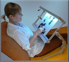 "Cross Stitch Stand with illumination Universal Needlepoint Hand embroidery Frame Standard Universal illuminated embroidery equipment (3 in 1) This product made in Ukraine (Europe). This equipment is made in a set and be transformed into sofa/floor/table (according to your own design) ""Standard"" (frame 60x30 cm) The equipment is completely transformed (packed size 15x20x70 cm, weight 2.5 kg) Special features: 1) Embedded illumination. LEDs - 12 WT/hour, flicker-tree light (similar to 80 WT..."