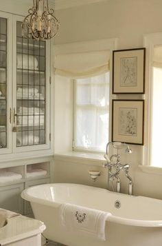 beautiful white bath, new vintage faucet,  and leaded glass linen closet