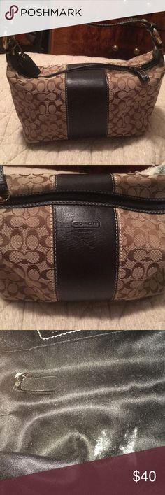 Coach Mini Purse brown coach bag with black leather down the center ! inside of bag has a little nail polish spill and a chalk stain that can easily be removed ! Coach Bags Mini Bags