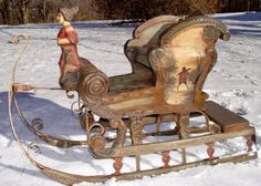 Victorian style polychromed wood, wrought iron, & gesso/plaster child's sleigh