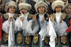 Young women dressed in traditional costume attend a ceremony in Astana, Kazakhstan.