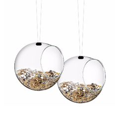Eva Solo Pair of Bird Feeders: The Mini bird feeders from Eva Solo are popular feeding stations for small birds and help them through the winter. The bird feeders are designed to resemble a weaver bird's nest, and are made of clear glass so you can observe visiting birds. They are both charming and decorative, and ready to hang in the garden or on the balcony.