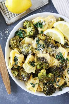 Lemon Broccoli Tortellini Recipe on twopeasandtheirpod.com Cheese tortellini with roasted broccoli, spinach, lemon, and parmesan cheese. This easy pasta dish is a favorite weeknight dinner.