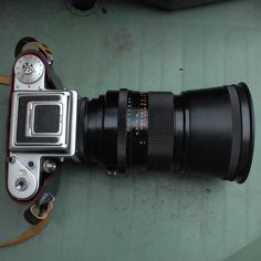 Carl Zeiss Jena Sonnar 180mm f/2.8 lens, late model MC (multicoated) with standard hood attached to Pentacon P6 TL