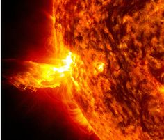 This image from June 20, 2013, at 11:15 p.m. EDT shows the bright light of a solar flare on the left side of the sun and an eruption of sola...