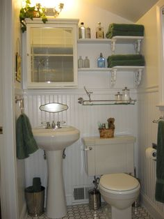 This is a bathroom we remodeled in our previous house.  prior to the remodel it was barbie pink tile, black wallpaper, dilapidated sink / cabinet, carpet over old ugly tile ....YUK!  We stripped it to the studs and redid everything! ervin0719