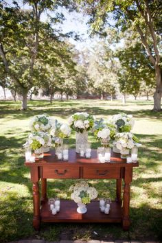 For the ceremony - Can use a regular console table for the wedding alter and decorate with some candles.