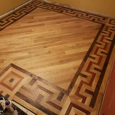 Faith Hardwood Flooring installed and finished this intricate floor for his wife for Christmas. Used Cardboard Boxes, Top Of Cabinets, Hardwood Floors, Flooring, Focal Wall, Mini Blinds, Under The Table, Holiday Lights, Other Rooms
