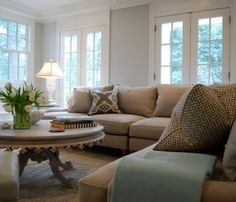 grey walls, tan couch by kelli