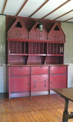 This cabinet is in Red House, built 1859-60 by Philip Webb, architect for William Morris. Morris lived here 1860-65.