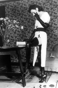 Holly Faram modelling Achilles' fetish boots by John Willie, 1930s from vintage spankings [ more at frenchtwist]