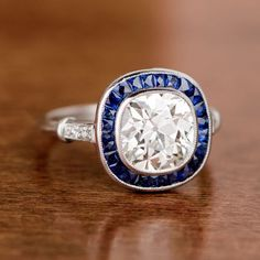 carat Diamond and Sapphire Engagement Ring. Antique Cushion Cut Diamond surrounded by Sapphires. Estate Engagement Ring, Colored Engagement Rings, Vintage Engagement Rings, Diamond Engagement Rings, Thing 1, Cushion Cut Diamonds, Vintage Diamond, Diamond Jewelry, Diamond Cuts