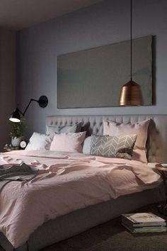 Pink, Grey and Copper tones in a bedroom for a warm and stylish look. Love the addition of green plants to left the pastel tones.