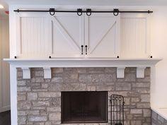 Mini barn door / sliding doors over fireplace. Classy way to cover ...