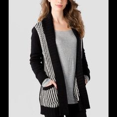 Oversized Boho Striped Cardigan Your go to black and white cardigan for this winter! Thick sweater material with functioning pockets. The back is solid black. Francesca's Collections Sweaters Cardigans