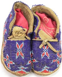 Pair childs moccasins with fully beaded uppers