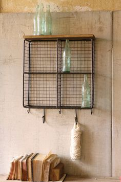"Featuring a wire mesh back, four cubbies for storage, and hooks for hanging sweaters and keys, this raw metal shelf is stylish and functional. Also sold as horizontal version. 20"" x 7"" x 26½""t"