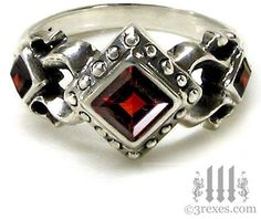 Google Image Result for http://data.whicdn.com/images/20867411/gothic-wedding-rings_large.jpg